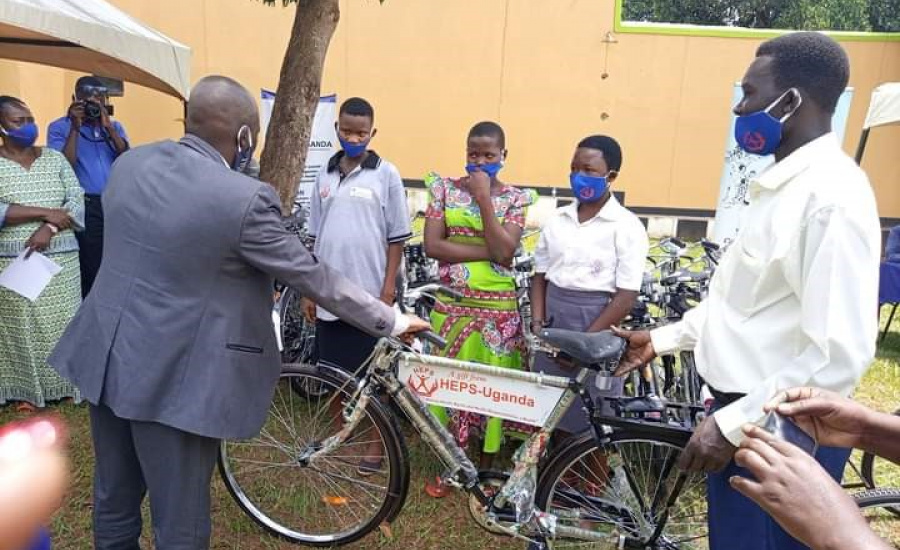 One of the HEPS community monitors receiving a bicycle